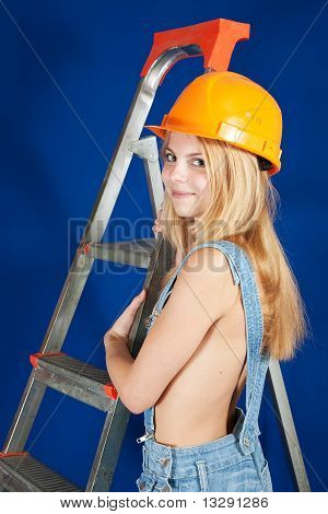 Sexy  Female  Builder  With Stepladder