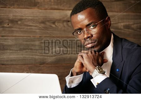 Portrait Of Successful Confident Young African Entrepreneur Wearing Glasses And Formal Suit Looking