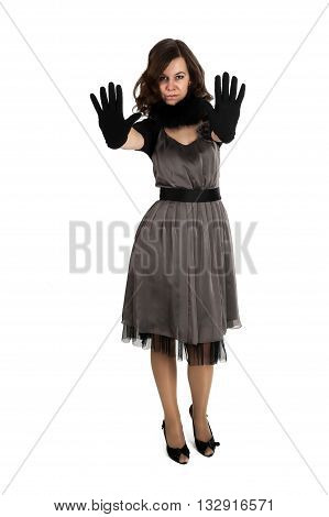 Young beautiful woman with gloves showing stop gesture