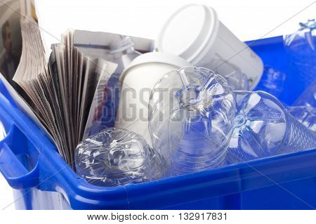 old papers and plastic bottles in dust bin