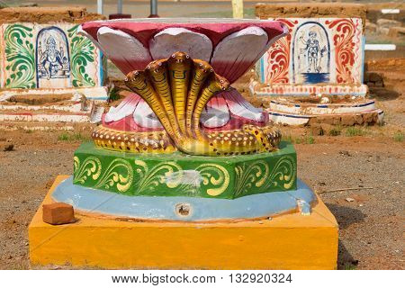Chettinad India - October 17 2013: Set of three colorful altars on square in Kothamangalam. First one shows lotus and five headed cobra. The other altars are for Lord Ganesha and Lord Ayyanar.