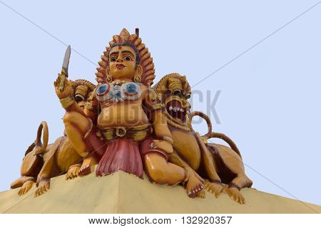 Chettinad India - October 17 2013: Statue of female Bootha Gana on the wall at Mariamman temple in Kothamargalam. She defends Lord Shiva and his family.
