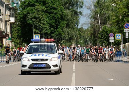 Orel Russia - May 29 2016: Russian Bikeday in Orel. Police car and bicyclists horizontal