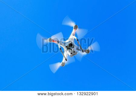 White Quadrocopter In Sky, Under Wireless Control