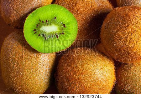 juicy sliced kiwi is on whole kiwi
