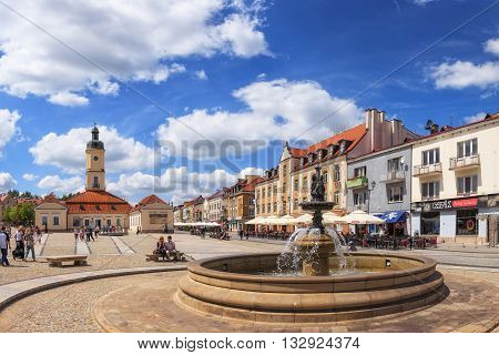 BIALYSTOK, POLAND - JULY 13: People walking on the Kosciusko Main Square with Town Hall on July 13, 2012 in Bialystok, Poland. Bialystok is a historical city with the fastest growth of capital in Poland.