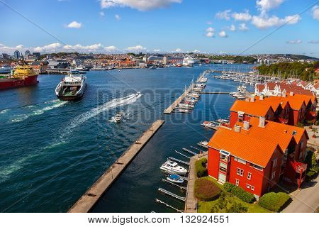 Cityscape of Stavanger Norway under blue cloudy sky.