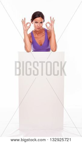 Healthy Pouting Brunette Behind Blank Placard