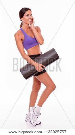 Healthy Smiling Brunette Holding Yoga Mat