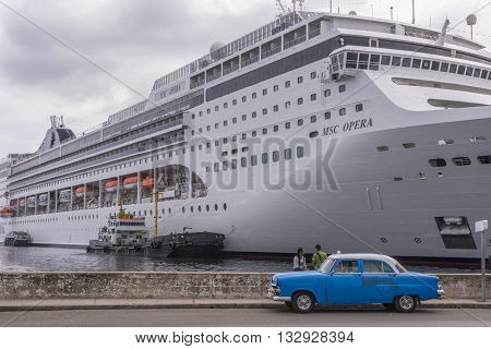 Havana, Cuba - january 19, 2016: A classic American car next to an ocean liner in the port of Havana , Cuba