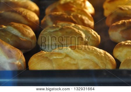 many eclairs cakes closeup in the oven cooking
