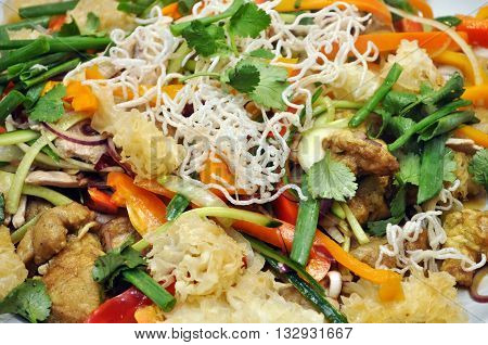 salad with vegetables and meat closeup background
