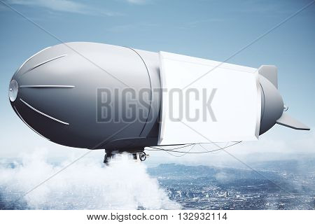 Sideview of airship with blank billboard in the sky above city. Mock up 3D Rendering