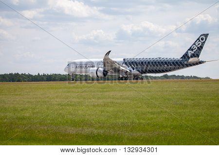 BERLIN / GERMANY - JUNE 32016: Airbus A 350 - 900 plane lands on airport in Berlin / Germany on June 3 2016.