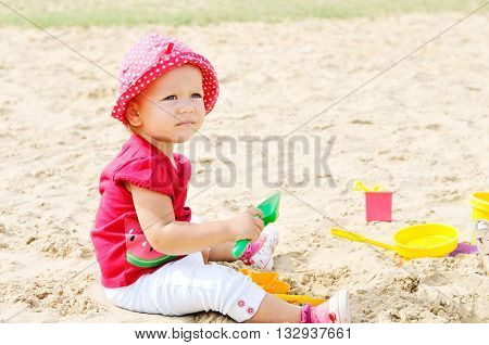 Baby Girl Is Playing In Sand