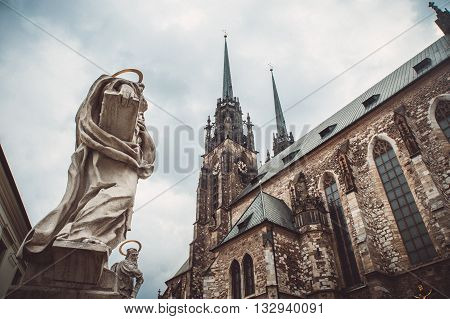 Bottom view on the Church of St. Peter and Paul in Brno and sculptures of saints on sky background