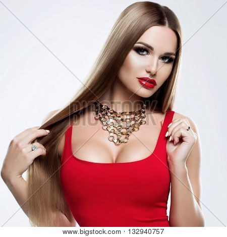 Beauty model girl with healthy blond streaked hair. Beautiful blonde woman with bright makeup, shiny straight hair. Hair. Hair products, hair care. Hair care, capacity. Isolated on white