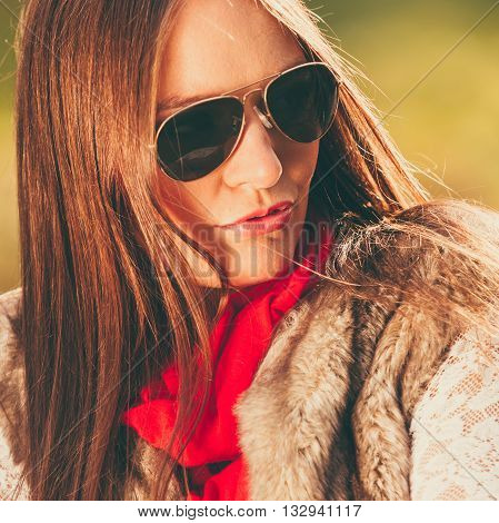 Fall lifestyle concept harmony freedom. Beauty young woman fashion girl in sunglasses relaxing walking in autumnal park outdoor