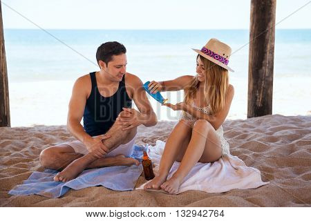 Cute Couple Putting On Some Sunblock