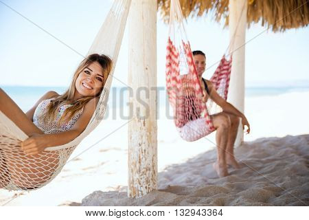 Cute Girl And Her Boyfriend In A Hammock
