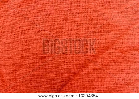 Close-up of cloth orange fabric texture little wrinkled
