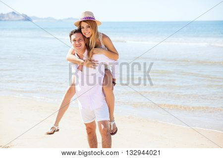 Young Couple Having Fun Together At The Beach