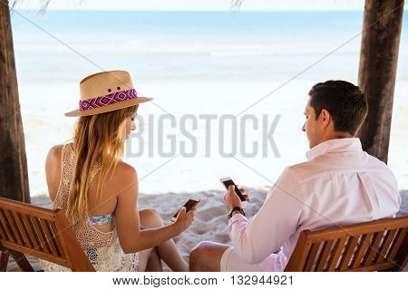 Young Couple Distracted By Technology