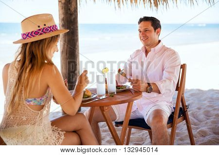 Man Eating Lunch With His Date At The Beach