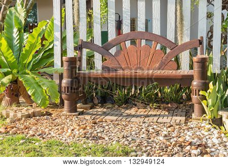 wooden swing chair in the garden Resting place nature select focus front wooden