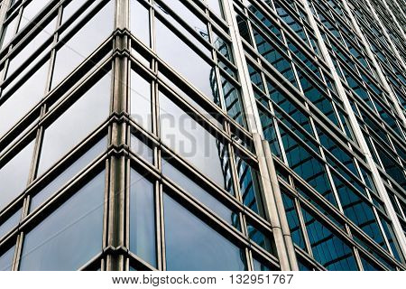 Office building corner with windows seen from below