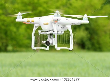 PILSEN CZECH REPUBLIC - JUNE 2, 2016: Drone quadrocopter Dji Phantom 3 Professional with camera. New tool for farmers use drones to inspect of cultivated fields. Modern technology in agriculture.