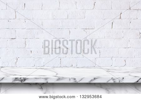 Empty white marble table on white brick wall background. For display or montage your products.
