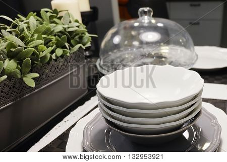Kitchen Utensil Set of Ceramic Dishes Bowls and Plates Preparing for Serve Hot and Cold Food.