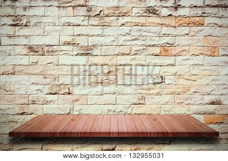 Empty wooden shelves and brick wall background. For display or montage your products.