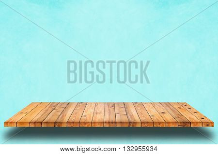 Empty wooden shelf on cyan wall background. For display or montage your products.