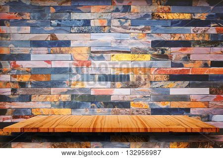Empty wooden shelves and marble stone wall background. For display or montage your products.
