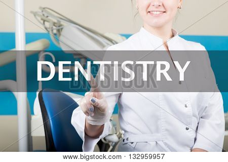 technology, internet and networking in medicine concept - medical doctor presses dentistry button on virtual screens. Internet technologies in medicine.