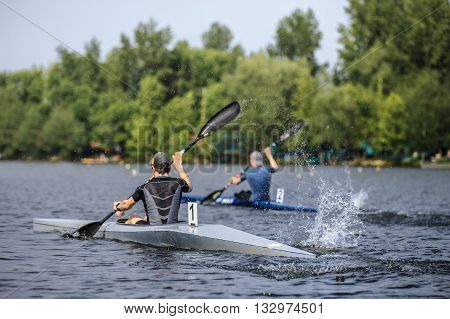 Chelyabinsk, Russia - May 28, 2016: rivalry between two athletes canoeists sprint race for rowing during Ural championship in rowing
