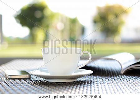 Coffee Cup With Book On Blurred Green Nature Background - Chill Out Concept