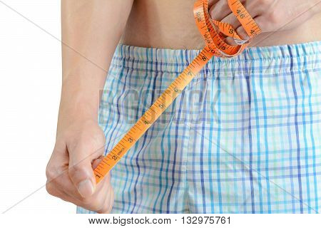Young Man Holding Tape Measure, Measuring His Penis