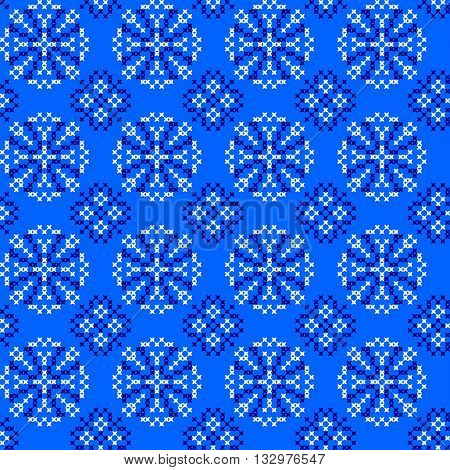 Seamless embroidered texture with abstract blue ornaments.Snowflakes.Patterns for cloth. Embroidery.Cross stitch