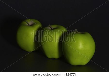 Line Of Green Apples Fade Into Black