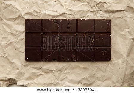 Freshly Baked Rustic Healthy Chocolate Bar With Nuts On Craft Paper, Top View