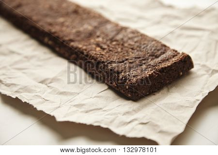 Closeup Focus On Rustic Freshly Baked Chocolate Bar With Berries And Grinded Nuts On Craft Paper