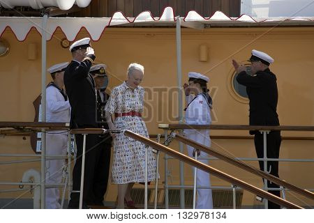 FREDERICIA DENMARK - 2016 Jun 5: The Danish queen in a maritime dress disembarking from the royal yacht Dannebrog in Fredericia harbor.