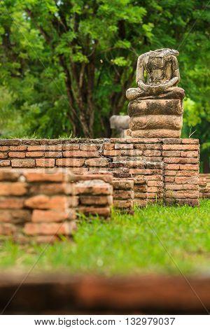 Ancient buddha no head in Ayutthaya Historical Park Ayutthaya Thailand.
