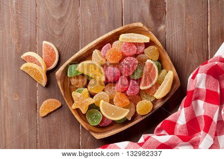 Colorful marmalade on wooden background. Top view