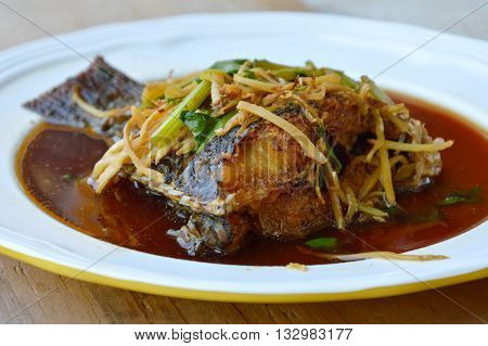 deep fried mango fish in ginger soy sauce on dish