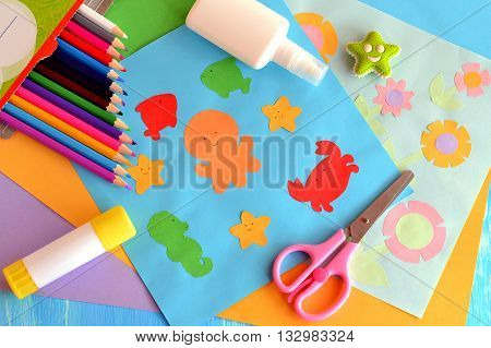 Paper marine animals and flowers cards. Glue stick, rubber, scissors, color paper, pencils. Creative and easy way to build up children imagination. Promote creative ability. Kindergarten art activity