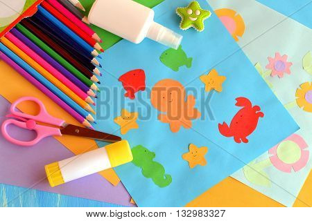 Paper sea animals and flowers crafts. A set of materials and tools for kids art. Easy way to realize kids imagination. Development of creative abilities in preschool children, primary school children.